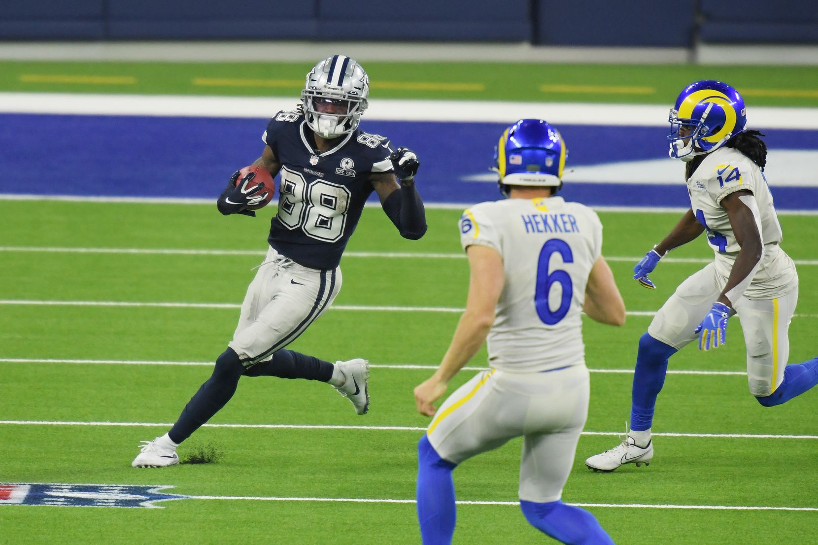 CeeDee Lamb #88 of the Dallas Cowboys returns a punt during the third quarter against the Los Angeles Rams at SoFi Stadium on September 13, 2020 in Inglewood, California.