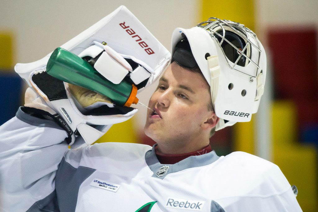 Goalie Jake Oettinger gets a drink of water between drills on the first day of Dallas Stars development camp at the Dr Pepper StarCenter on Saturday, July 8, 2017, in Frisco.