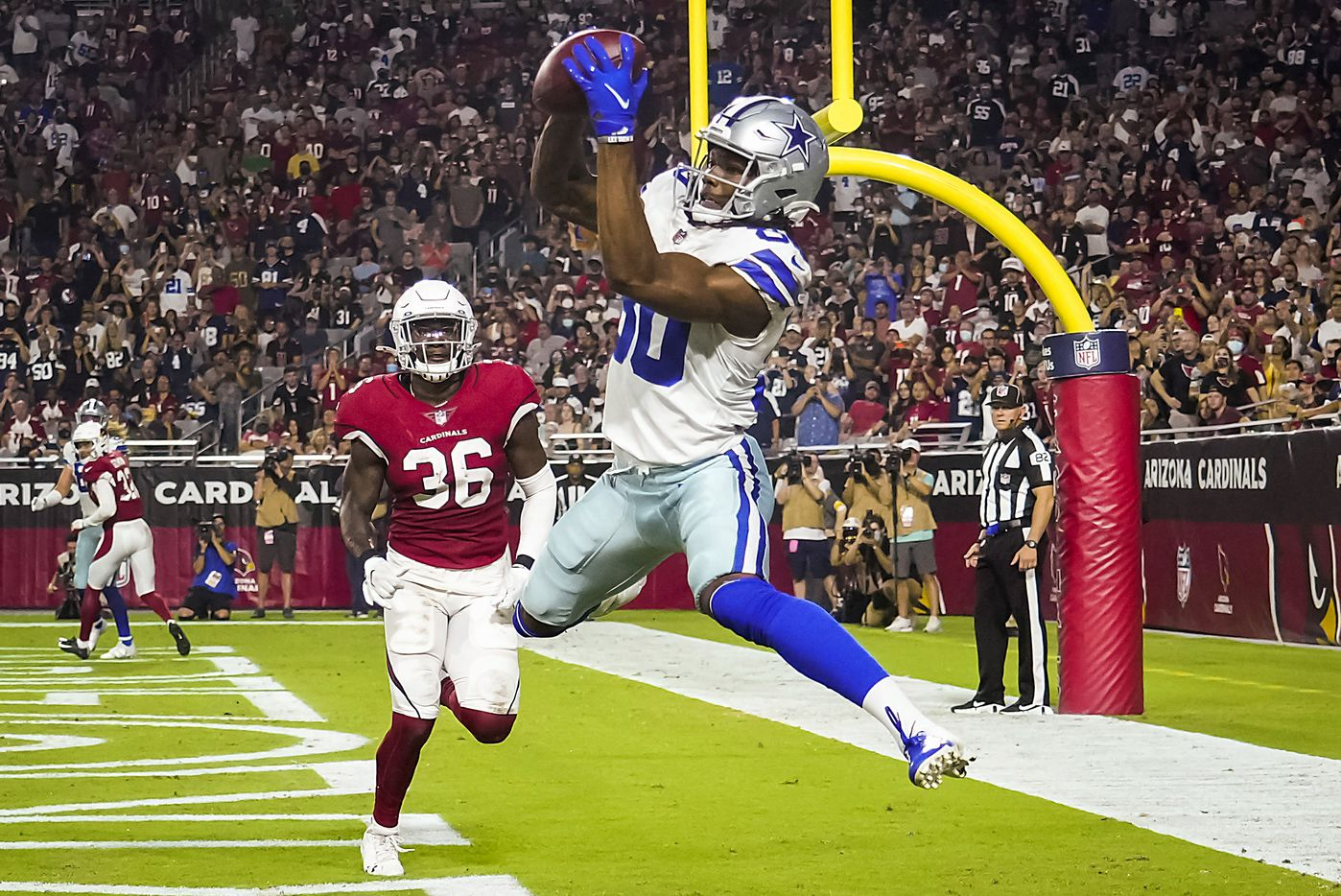 Dallas Cowboys wide receiver Brandon Smith (80) catches a 1-yard touchdown pass from quarterback Ben DiNucci as Arizona Cardinals safety Shawn Williams (36) defends during the second half of a preseason NFL football game at State Farm Stadium on Friday, Aug. 13, 2021, in Glendale, Ariz.