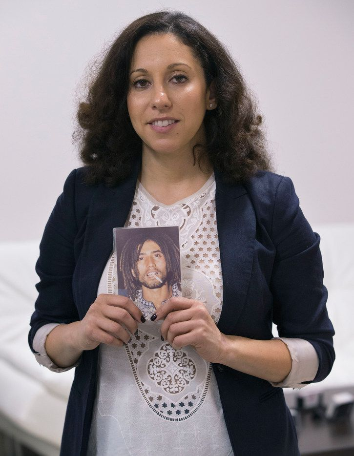 Sara Mokuria, Mothers Against Police Brutality co-founder, holds a picture of her father, Tesfaie Mokuria.