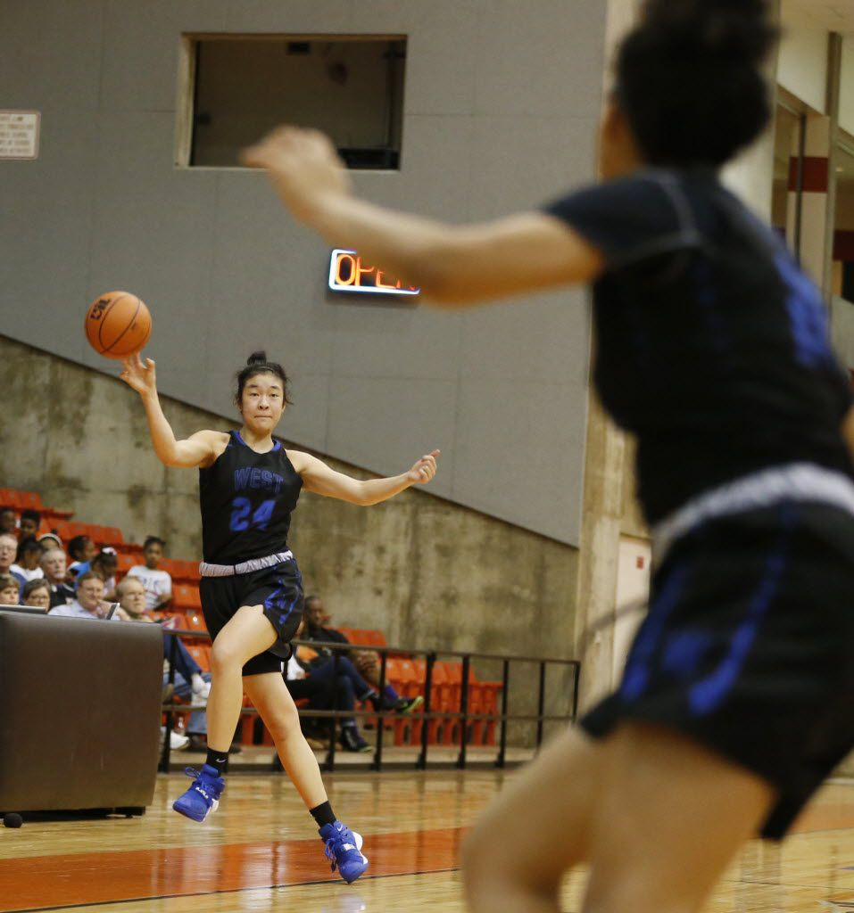 Plano West's Natalie Chou (24) saves the ball and passes to teammate Jalyn Hodge (22) in a game against Amarillo during the first half of play in a 6A girls regional semifinal playoff game at Wilkerson Greines Athletic Center in Fort Worth on Friday, February 26, 2016. (Vernon Bryant/The Dallas Morning News)
