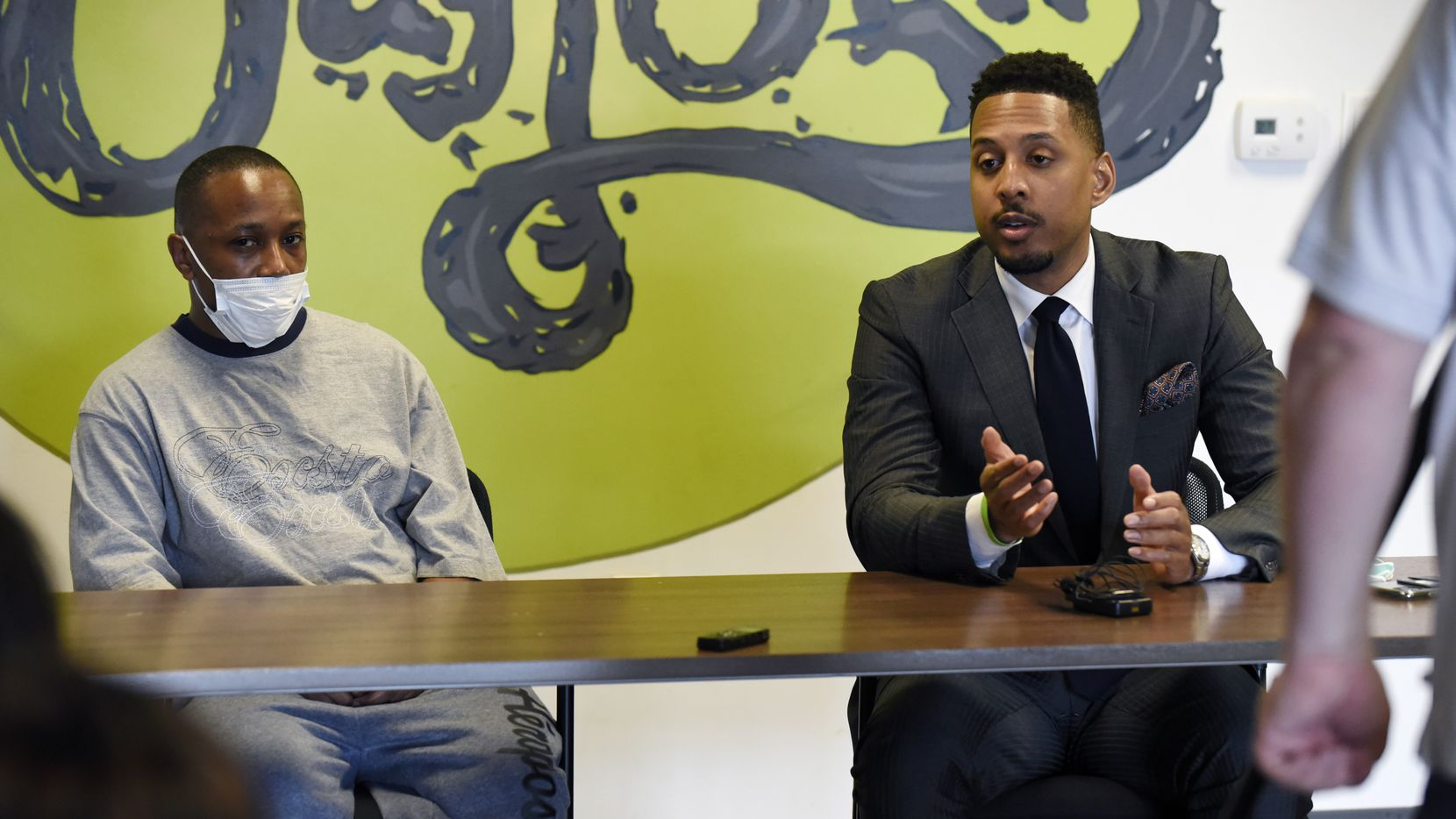 Alvin Ross, left, sits next to attorney Justin Moore, as he speaks about Alvin's sister Diamond Ross and the family's case against the Dallas Police Department, at the For Oak Cliff community offices in Dallas, Thursday June 25, 2020. Diamond Ross passed away in Dallas police custody in 2018. Ben Torres/Special Contributor