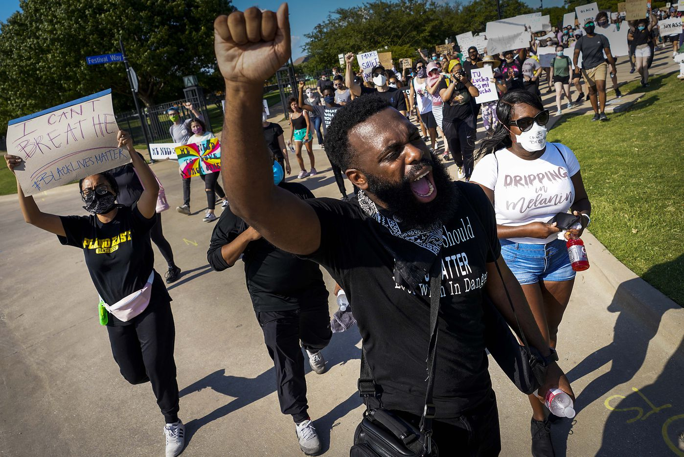Brandon Moore leads marchers during a protest on Thursday, June 4, 2020, in Addison. Protests continued Thursday in the response to the death of George Floyd.