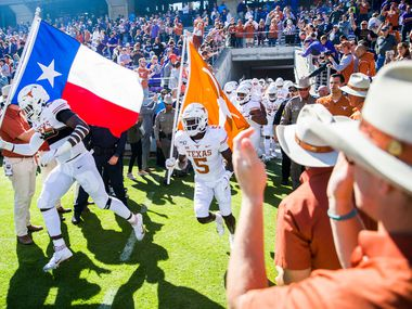 Texas Longhorns enter the field before an NCAA football game between the University of Texas and TCU on Saturday, October 26, 2019 at Amon G Carter Stadium in Fort Worth.