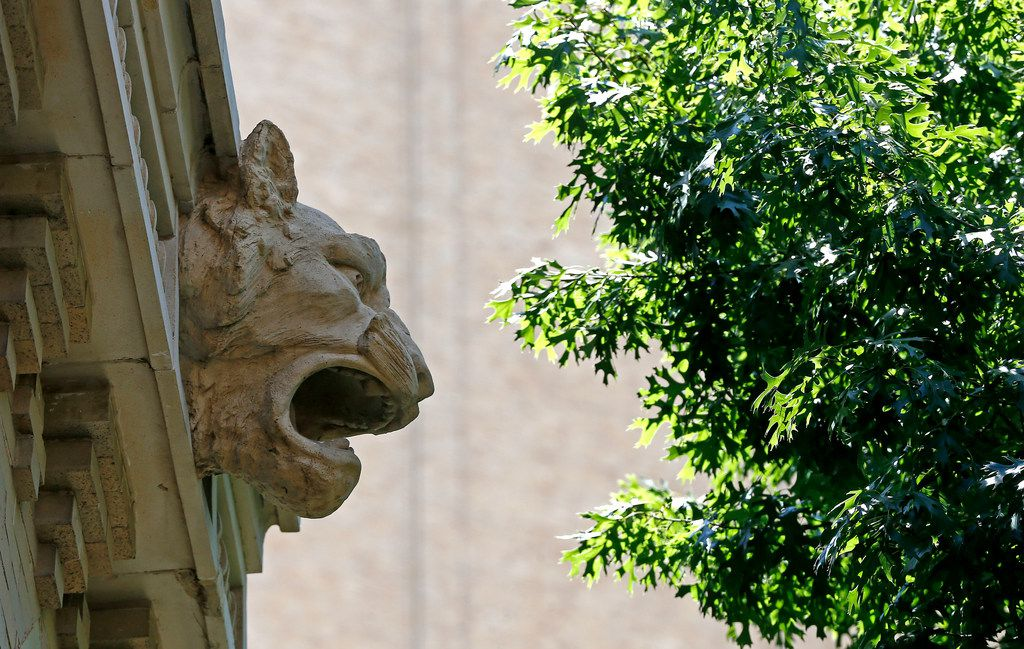 The Flatiron Building features carved panther heads on its facade in Fort Worth.