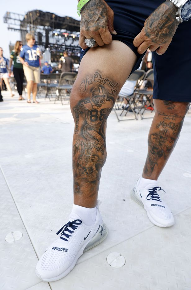 Mark Shenefild shows off his tattoo of Pro Football Hall of Fame inductee Drew Pearson of the Dallas Cowboys before he was introduced during the Class of 2021 enshrinement ceremony at Tom Benson Hall of Fame Stadium in Canton, Ohio, Sunday, August 8, 2021. (Tom Fox/The Dallas Morning News)
