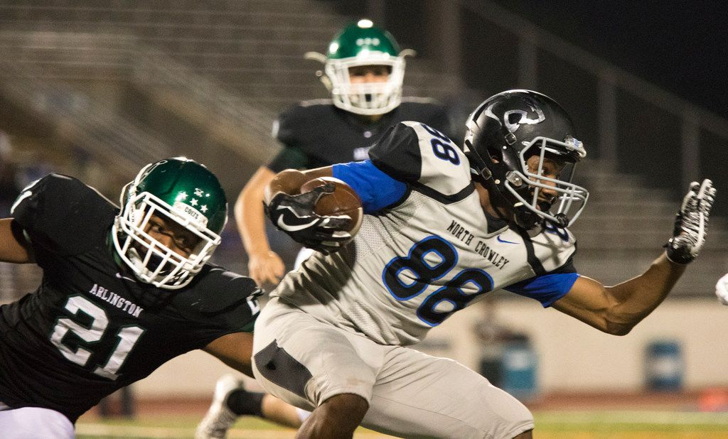 North Crowley wide receiver Chris Taylor (88) attempts to rush through the defense during a high school football matchup between North Crowley and Arlington on Sept. 29, 2017, at Maverick Stadium in Arlington. (Andrew Buckley/Special Contributor)