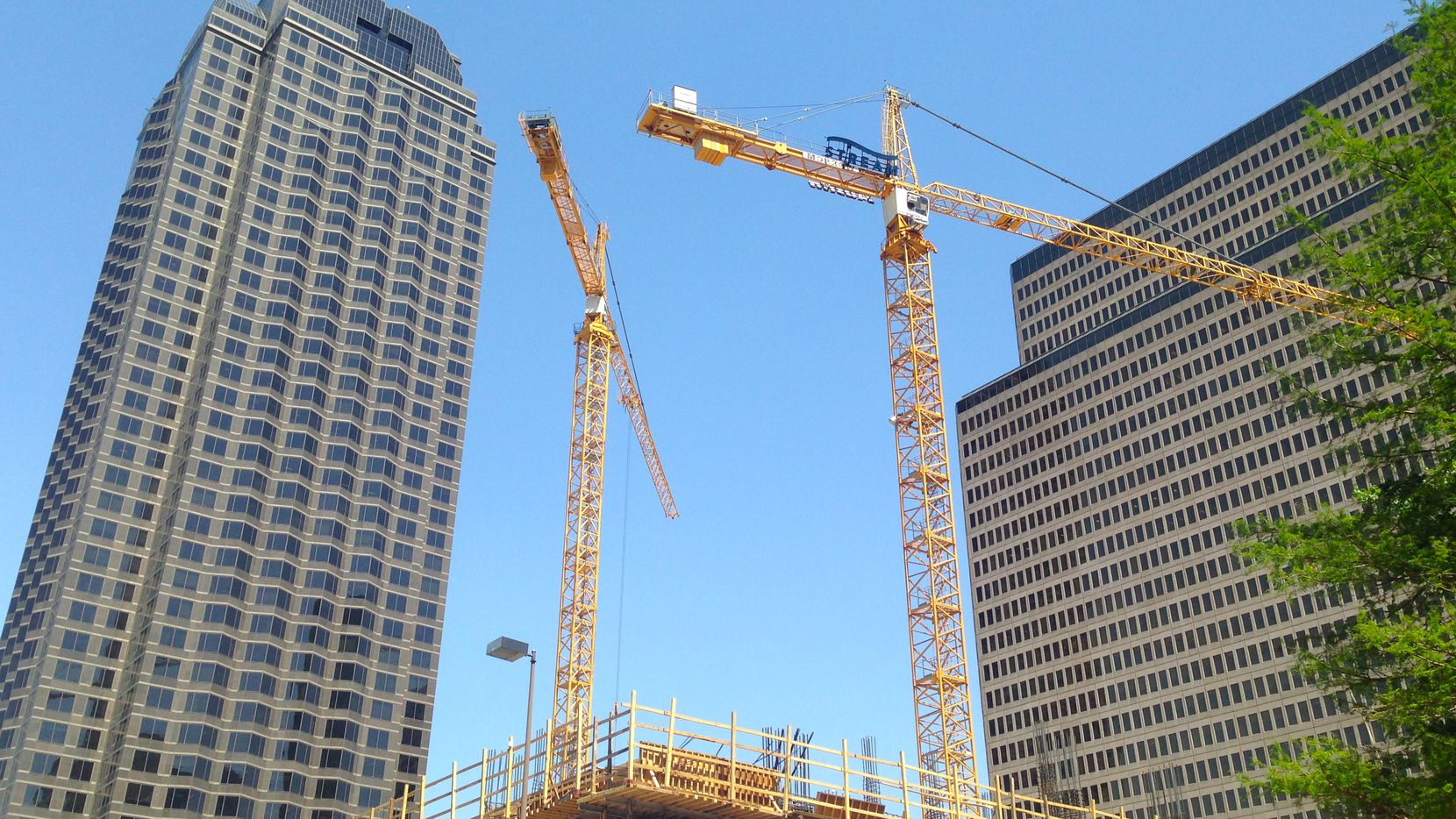 Big job and population gains in Dallas-Fort Worth are keeping the cranes flying on the skyline.