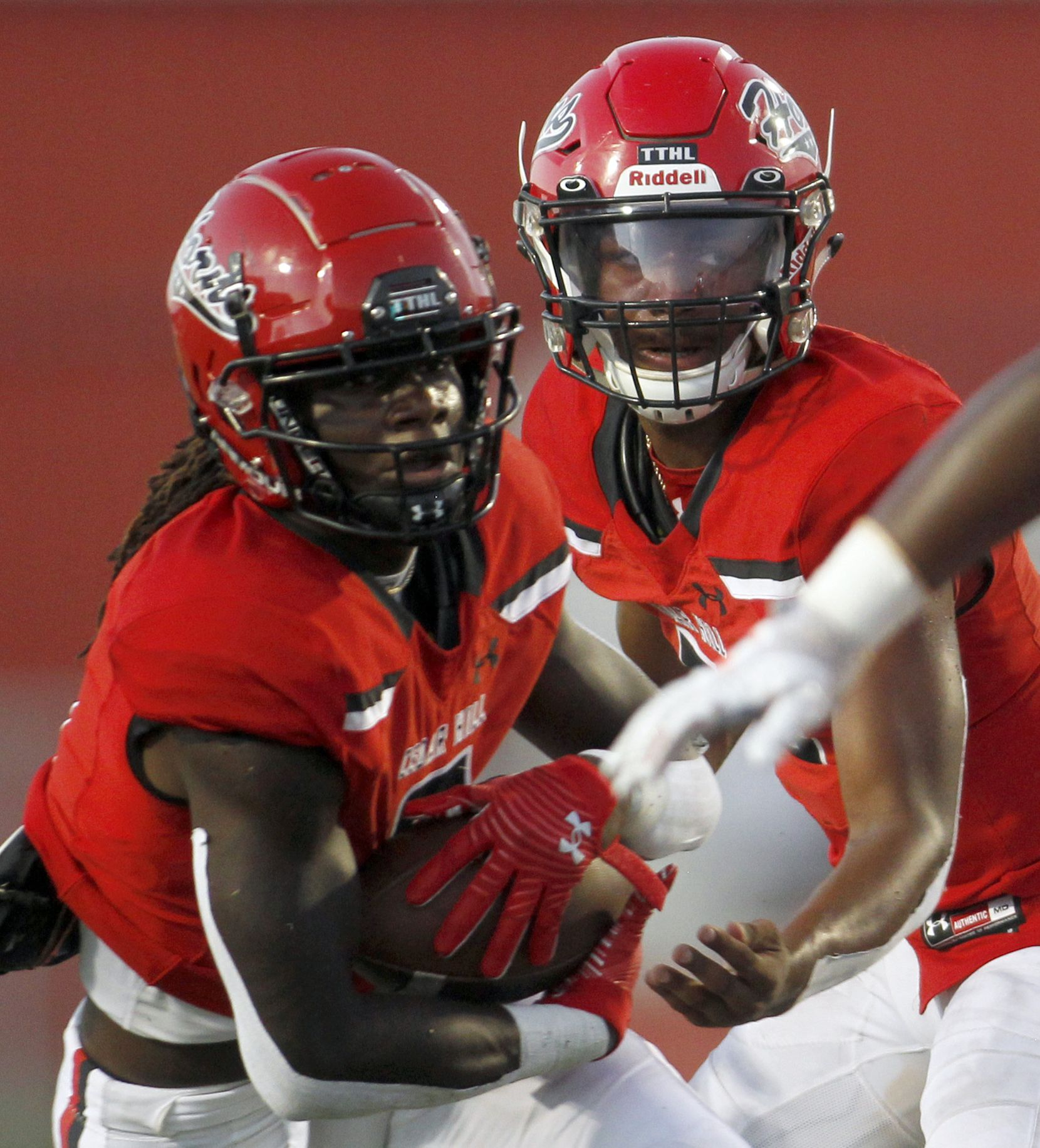 Cedar Hill quarterback Cedric Harden (5), right, hands off to running back Robert Richardson (6) during a first half rush in their game against Rockwall. The two teams played  their season opening football game at Longhorn Stadium in Cedar Hill on August 27, 2021. (Steve Hamm/ Special Contributor)