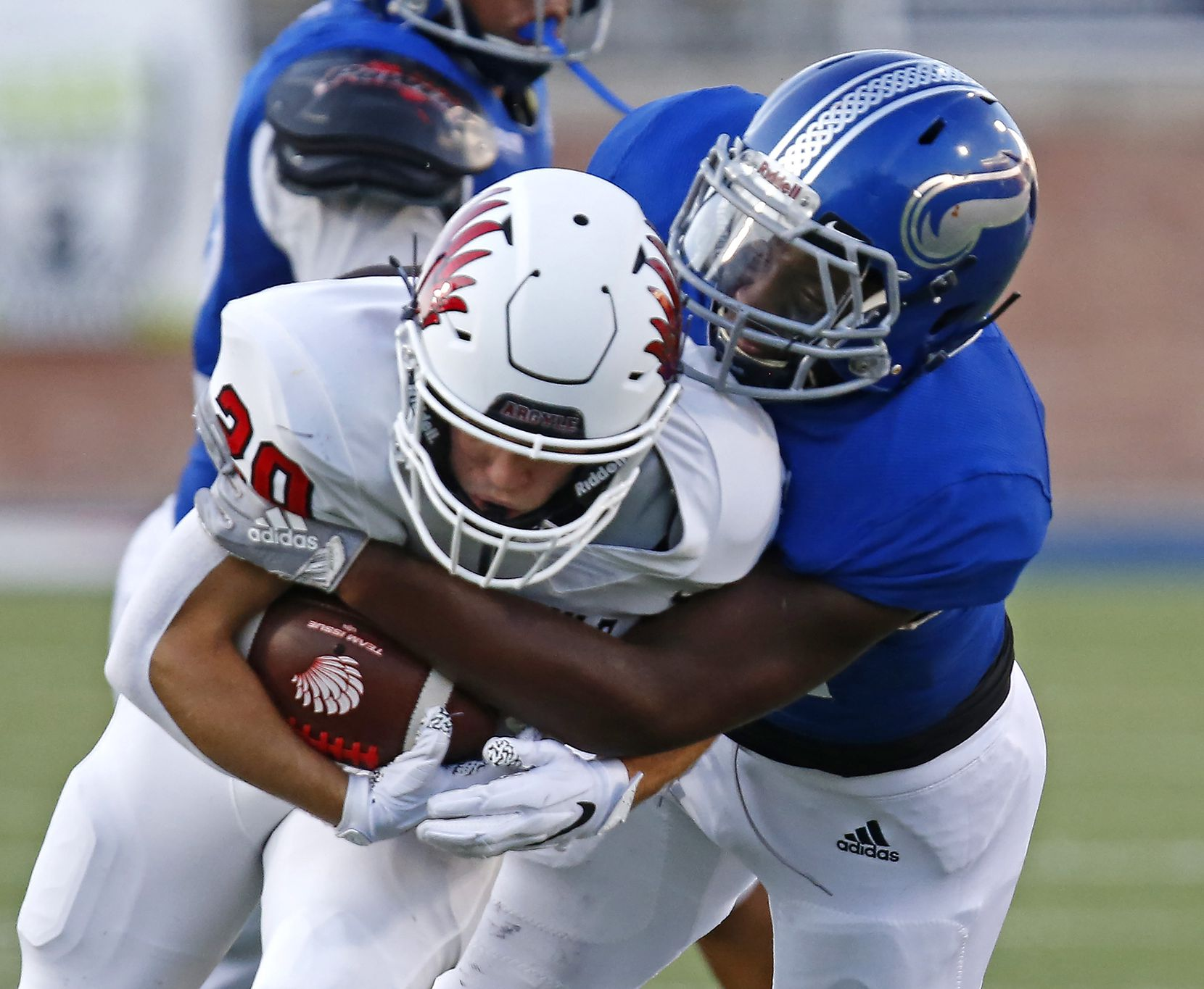 Nolan Catholic High School middle linebacker T.K. Woodson (44) tackles Argyle High School running back Landon Ferris (20) during the first half as Argyle High School hosted Nolan Catholic High School at Eagle Stadium in Allen on Saturday evening, August 28, 2021. (Stewart F. House/Special Contributor)