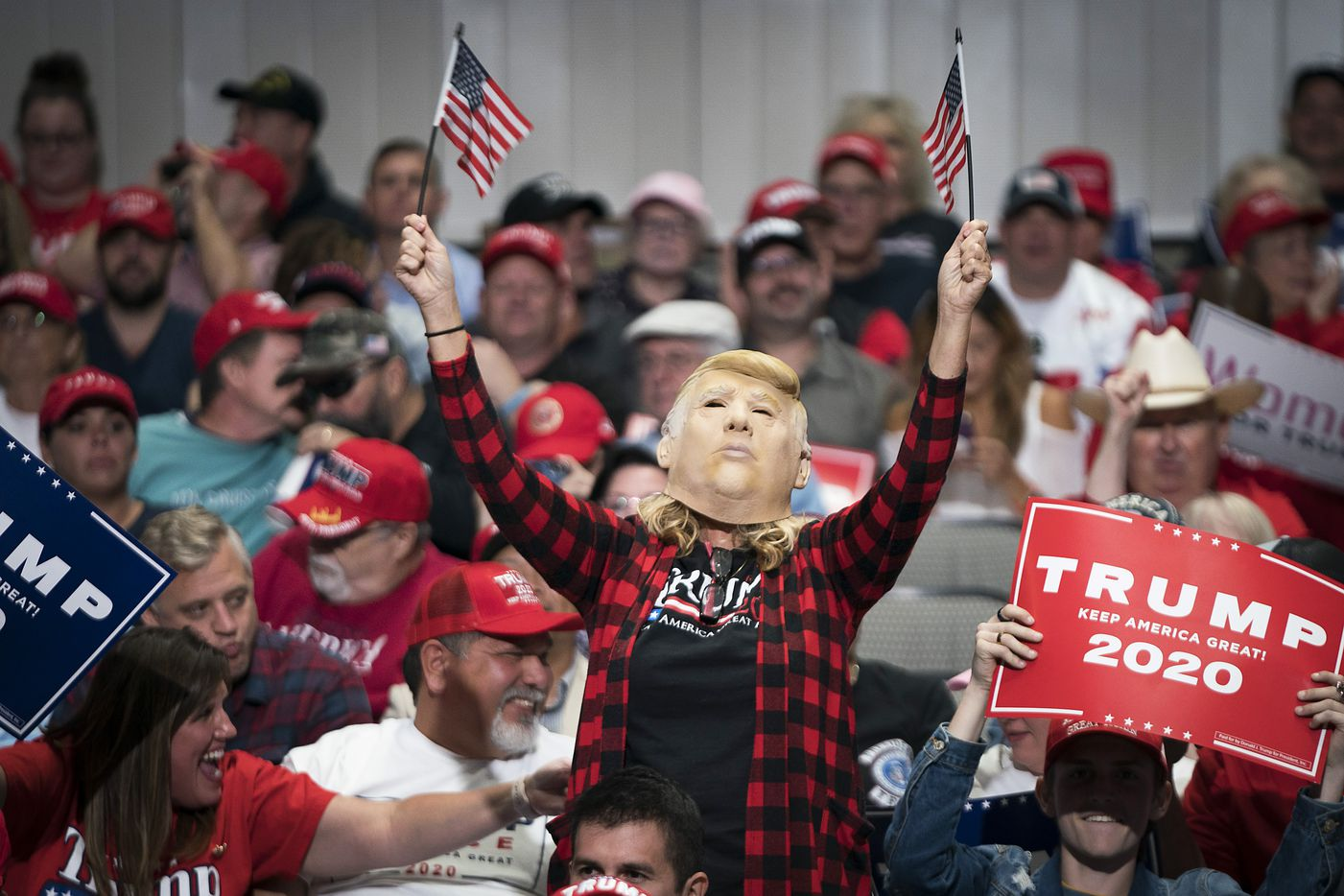 Supporters cheer President Donald Trump before his arrival at campaign rally at the American Airlines Center on Thursday, Oct. 17, 2019, in Dallas.