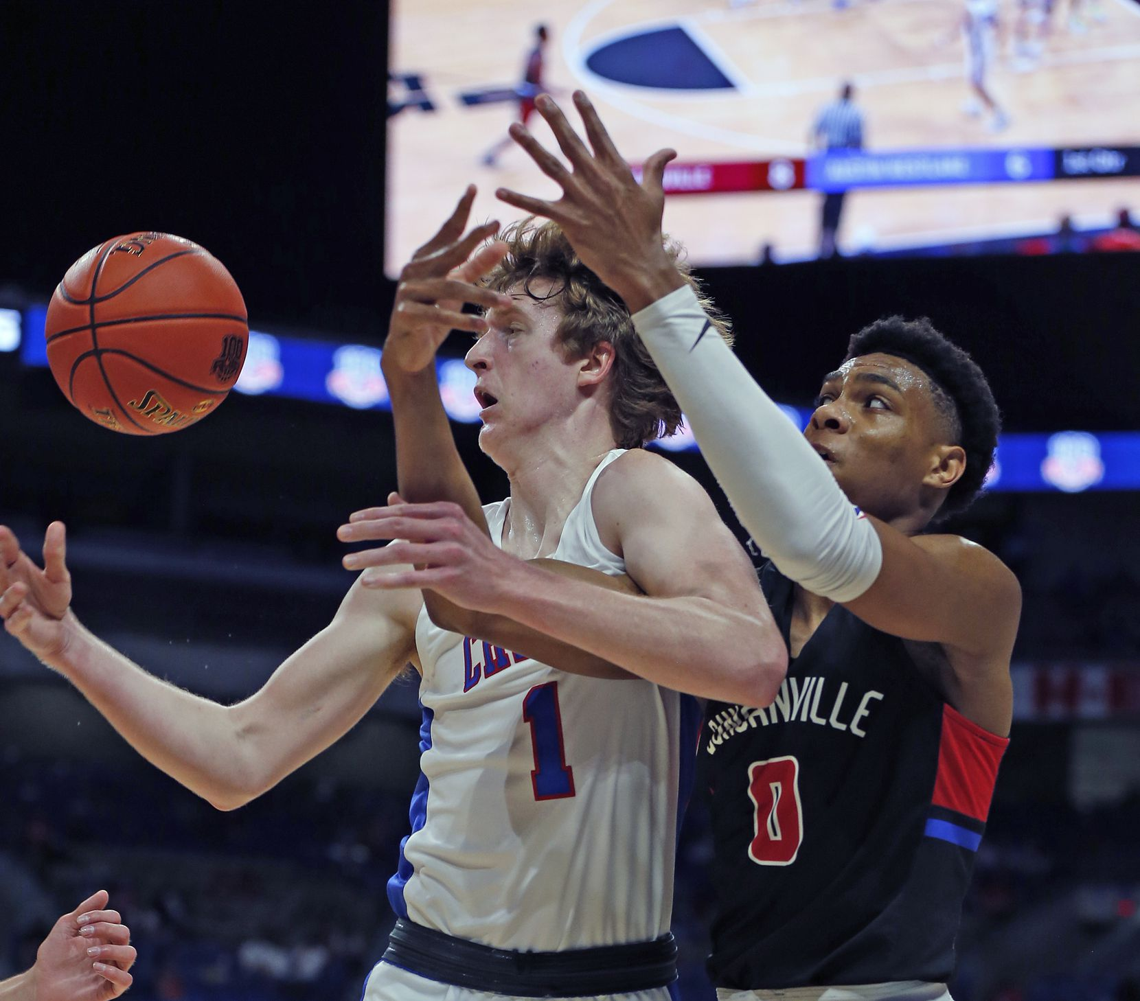 Duncanville Zhuric Phelps #0 battles Westlake Cade Mankle #1 for a rebound. UIL boys Class 6A basketball state championship game between Duncanville and Austin Westlake on Saturday, March 13, 2021 at the Alamodome.
