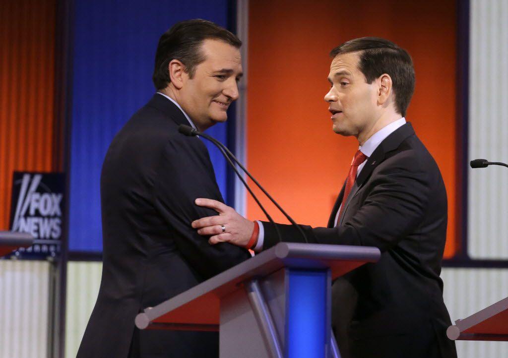Sens. Ted Cruz and Marco Rubio chatted after a Republican presidential primary debate Jan. 28 in Des Moines, Iowa.