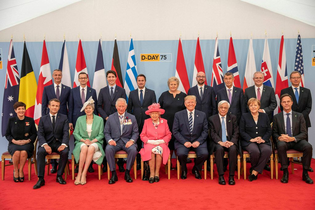 Britain's Queen Elizabeth II, accompanied by The Prince of Wales, pose for a formal photograph with leaders of the other Allied Nations ahead of the National Commemorative Event commemorating the 75th anniversary of D-Day, in Portsmouth, England, Wednesday June 5, 2019. Back row from left: Slovakia Deputy PM Richard Rasi, Poland PM Mateusz Morawiecki, Canada PM Justin Trudeau, Luxembourg PM Xavier Bettel, Norway PM Erna Solberg, Belgium PM Charles Michel, Czech Republic PM Andrej Babis, Australia PM Scott Morrison, Danish Ambassador to the UK Lars Thuesen. Front row from left: Governor-General of New Zealand Patsy Reddy, President of France Emmanuel Macron, Britain's PM Theresa May, Prince Charles, Queen Elizabeth II, US President Donald Trump, President of Greece Prokopis Pavlopoulos, Chancellor of Germany Angela Merkel, Prime Minister of the Netherlands Mark Rutte. Commemoration events are marking the 75th anniversary of the D-Day landings when Allied forces stormed the beaches of Normandy in northern France during World War II.