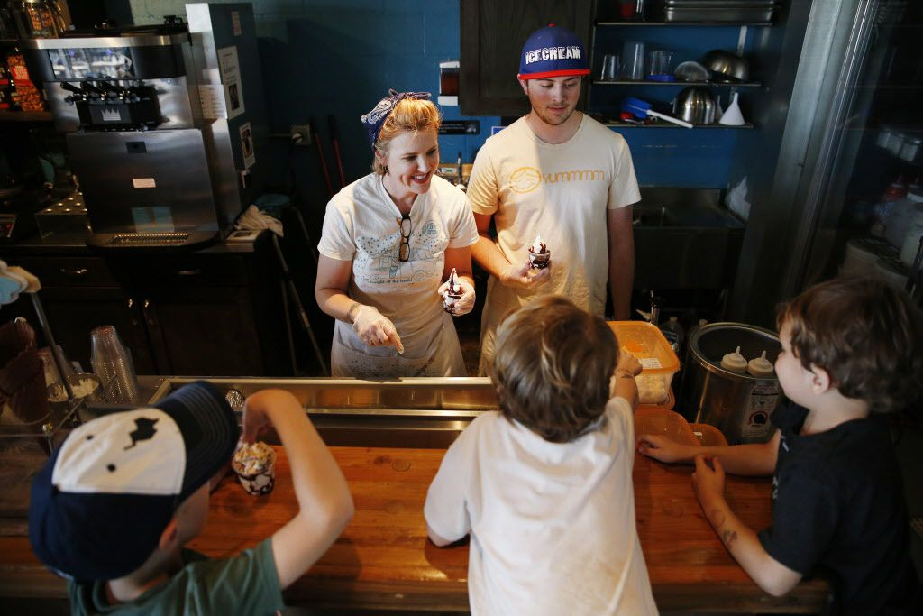 Corey Sorensen (back left) and her son, Cole Sorensen (back right) serve to Henry McKibben (from bottom left) and brother Tex Mayes and Wyatt Mayes, all 6 years old, inside the Cow Tipping Creamery store located off Peavy Road in Dallas Tuesday March 15, 2016. Cow Tipping Creamery started as food truck in Austin in 2012. The Dallas location, which has not yet opened, is the first storefront for the brand. The company is family-owned by Corey and Timothy Sorensen of Austin, and their son, Cole, 21, works out of the food truck. The store is located inside the Good 2 Go Taco shop. (Andy Jacobsohn/The Dallas Morning News)