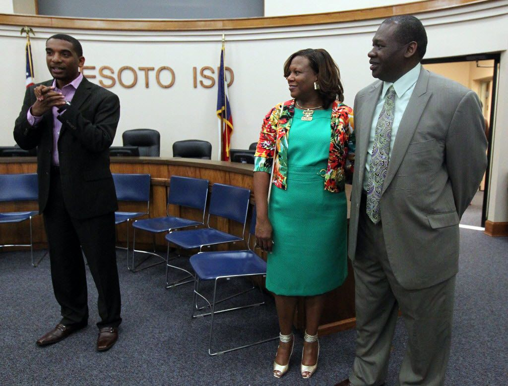 David Harris (right) took over as DeSoto ISD superintendent in April 2012. That spring, Harris and his wife, Lesa Harris (center), attended an open house reception at the district's administration building.  Warren Seay Jr., president of the school board at the time, is at left.