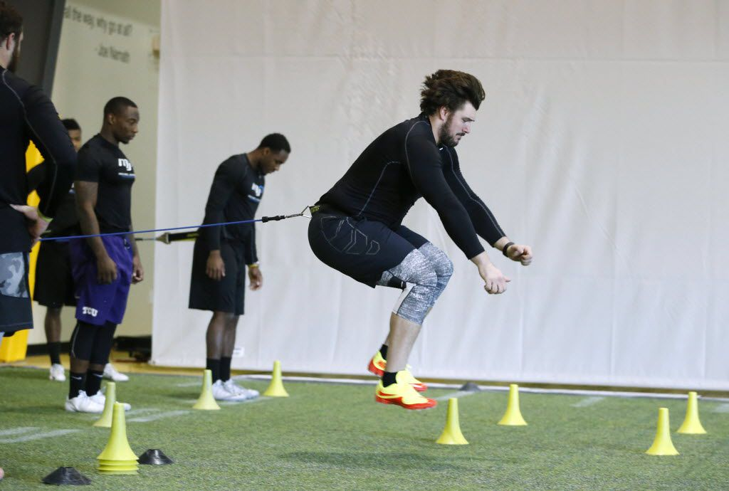 Connor McGovern, offensive lineman from the University of Missouri leaps in an exercise during a workout at Michael Johnson Performance Center in McKinney on Wednesday, February 17, 2016. The athletes are preparing for next week's NFL Scouting Combine. (Vernon Bryant/The Dallas Morning News)