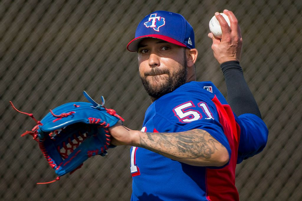 Texas Rangers pitcher Matt Bush participates in pitchers fielding practice during a spring training workout at the team's training facility on Saturday, Feb. 17, 2018, in Surprise, Ariz. (Smiley N. Pool/The Dallas Morning News)