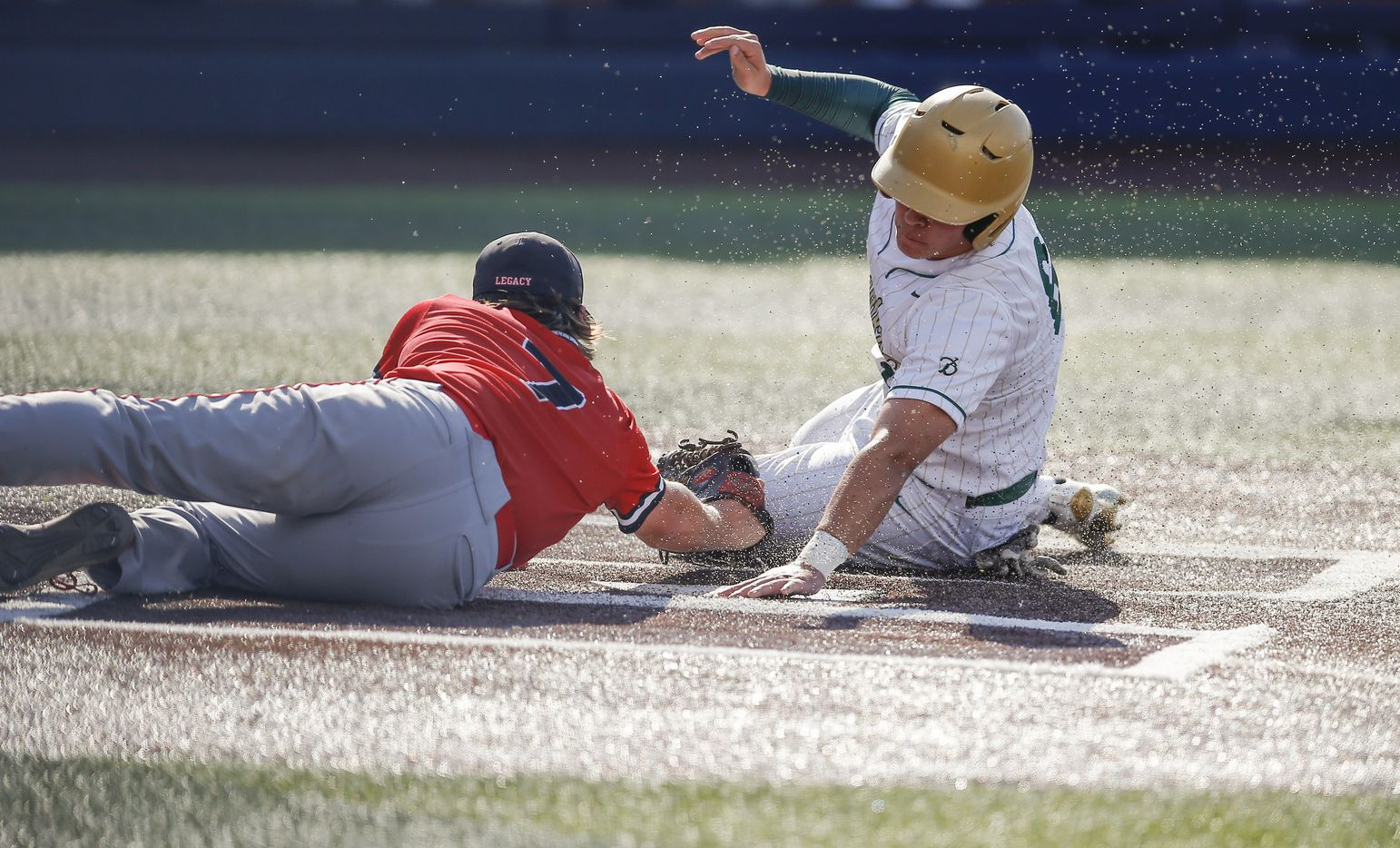 Mansfield Legacy pitcher Drake Dowd (7) is unable to make the tag as Birdville's Bynum Martinez (6) scores during the second inning of a high school Class 5A Region I  quarterfinal series baseball game at Dallas Baptist University, Thursday, May 20, 2021. (Brandon Wade/Special Contributor)