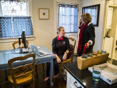 Sharla Elizalde (left) of Austin talks with AirBnb owner Kathi Chandler (right) as she works in the kitchen of an AirBnb on N Windomere Ave on Tuesday, February 18, 2020 in Dallas. Elizalde and her husband are repeat customers.