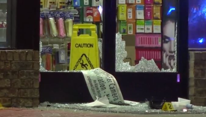 The windows of the front door of an Irving 7-11 were shattered Thursday morning after an armed man robbed the store and then was fatally shot in a confrontation with police.