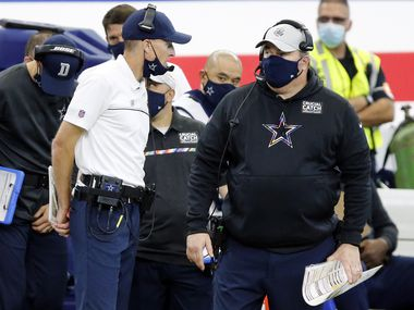 Dallas Cowboys head coach Mike McCarthy (right) visits with his special teams coordinator John Fassel during their game against the Cleveland Browns at AT&T Stadium in Arlington, Texas, Sunday, October 4, 2020. The Cowboys lost, 48-39.