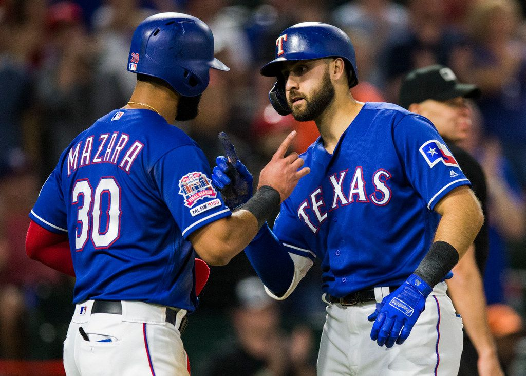 Texas Rangers center fielder Joey Gallo (13) celebrates with right fielder Nomar Mazara (30) after crossing home plate from a home run during the eighth inning of an MLB game between the Texas Rangers and the Seattle Mariners on Tuesday, May 21, 2019 at Globe Life Park in Arlington.