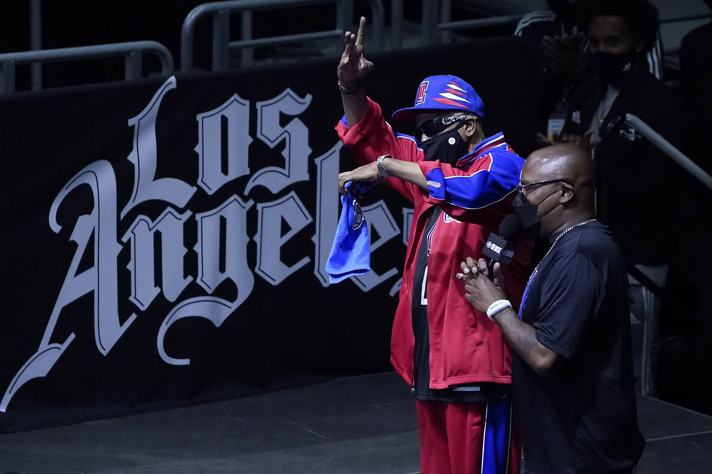 Rapper Tone Loc motions to the crowed during the first half of an NBA playoff basketball game between the Dallas Mavericks and the LA Clippers at Staples Center on Tuesday, May 25, 2021, in Los Angeles.