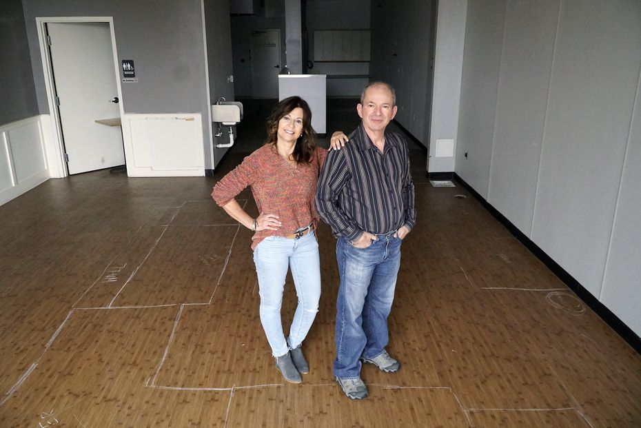 Lisa and Kyriakos Kouzoukas pose at the home of their future bagel shop in Richardson.