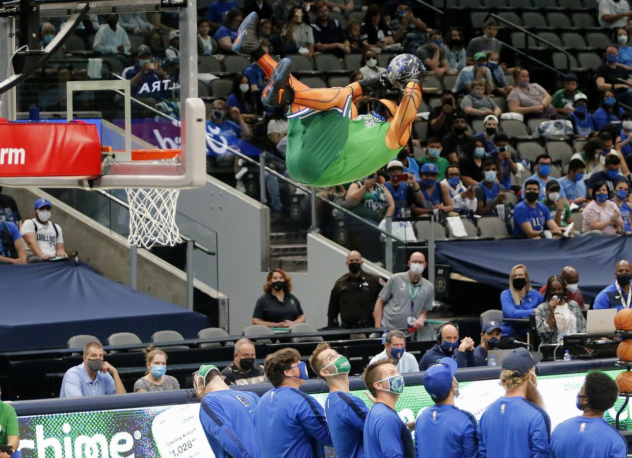 Mavs Man does some trampoline dunks before the scrimmage as the Dallas Mavericks held their Mavs Fam Jam, a scrimmage free to the public at the American Airlines Center in Dallas on Sunday, October 3, 2021. (Stewart F. House/Special Contributor)