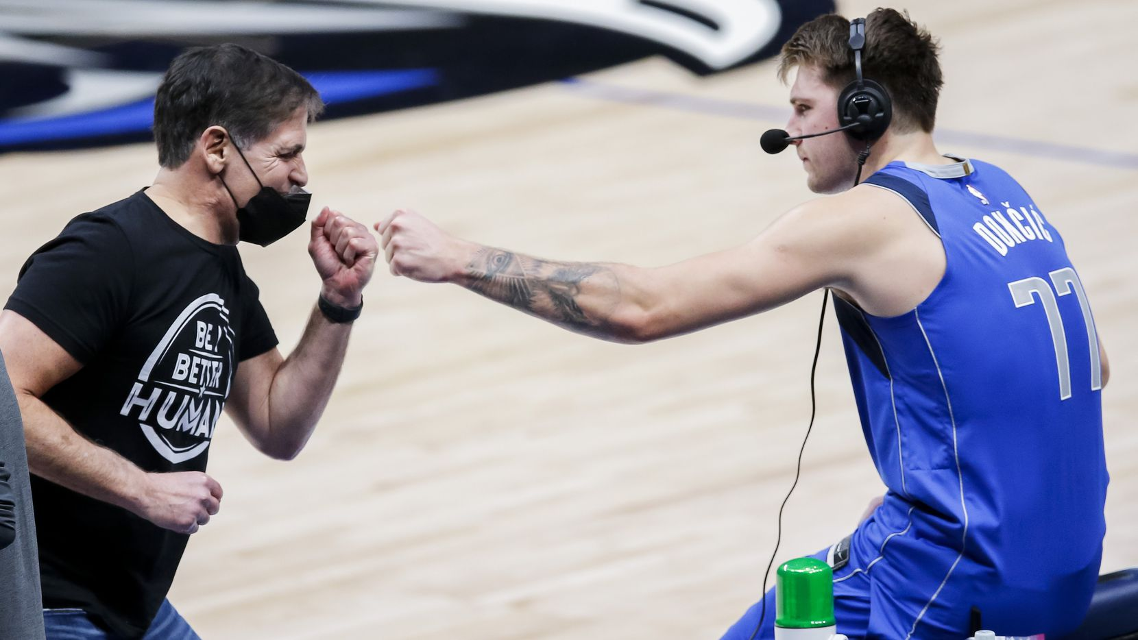 Dallas Mavericks owner Mark Cuban fist bumps guard Luka Doncic (77) after a 118-117 win over the Atlanta Hawks in an NBA basketball game in Dallas, Wednesday, February 10, 2021.