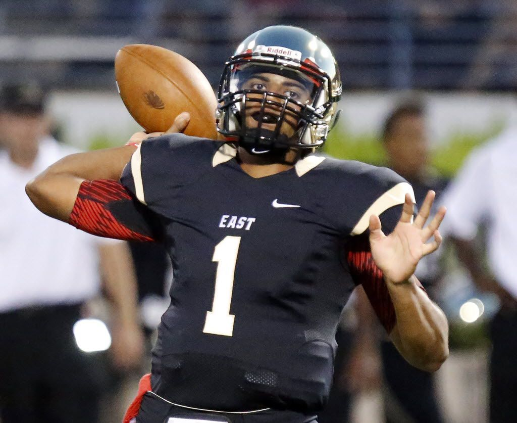 Plano East quarterback Miklo Smalls (1) throws a pass in the first quarter as Plano East High School hosted Plano West High School at Kimbrough Stadium in Plano on Friday, September 18, 2015.