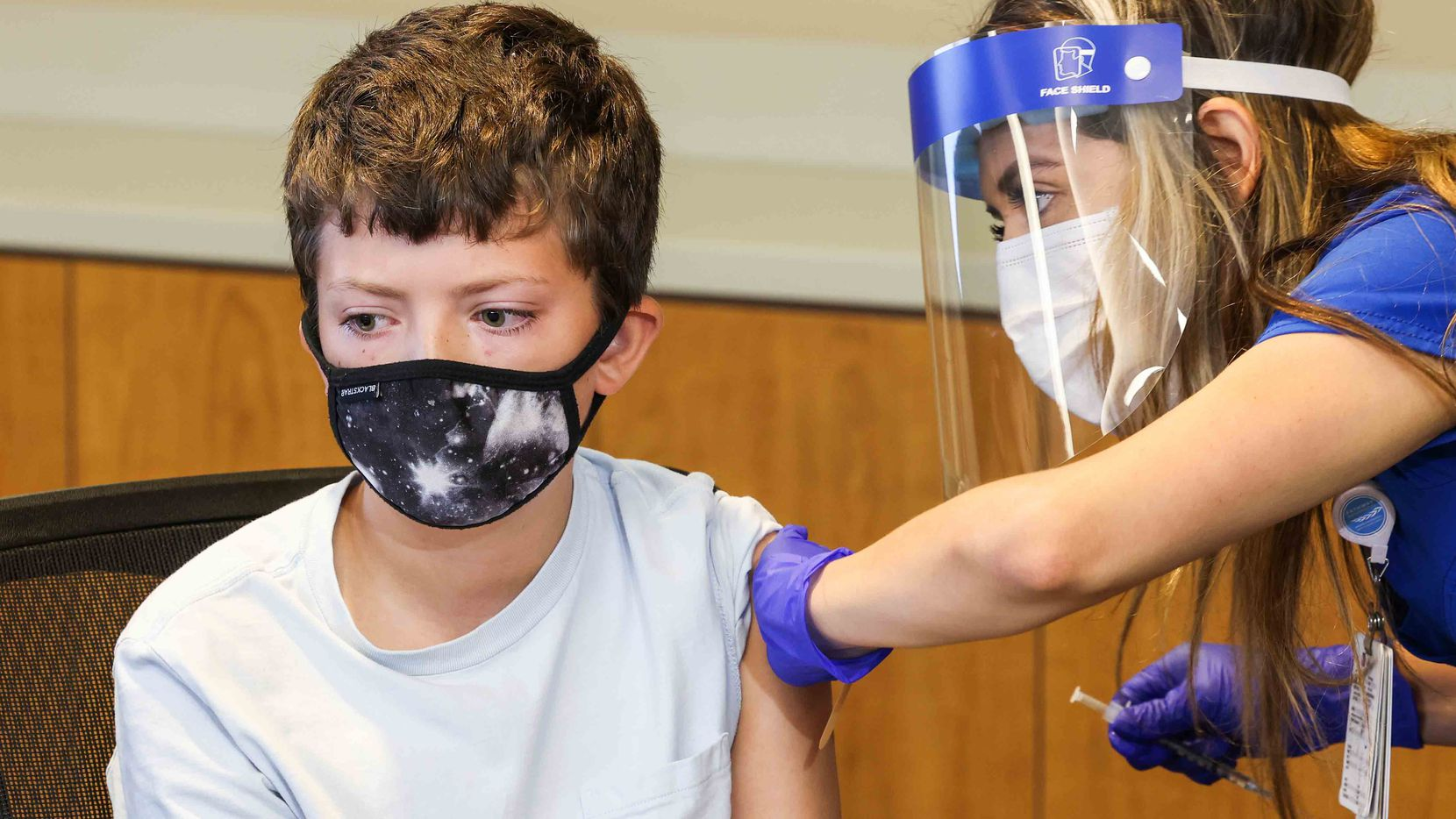 Henry Ricketts, 12, receives a COVID-19 vaccine as one of the first minors under 16 years old to get vaccinated in Dallas County at WISH Clinic Building at Parkland Memorial Hospital in Dallas on Thursday, May 13, 2021. (Lola Gomez/The Dallas Morning News)