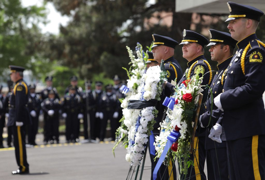 Police stand at attention during Wednesday's ceremony at the Dallas Police Memorial. (Jason Janik/Special Contributor)