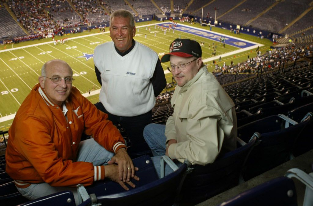 "From left, Mike Zoffuto, Eddy Clinton and Denny Garver photographed during halftime of the Richardson Berkner vs. Dallas Carter playoff game at Texas Stadium, Friday night, November 14, 2003.  The three men were broadcasters of the ""famous"" Plano East-Tyler John Tyler game in the 90's.  For ""Where Are They Now"" feature."