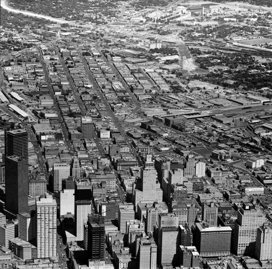 A 1963 aerial photo by Tom Dillard shows downtown Dallas before the construction of I-345. The Cotton Bowl can bee seen at top.