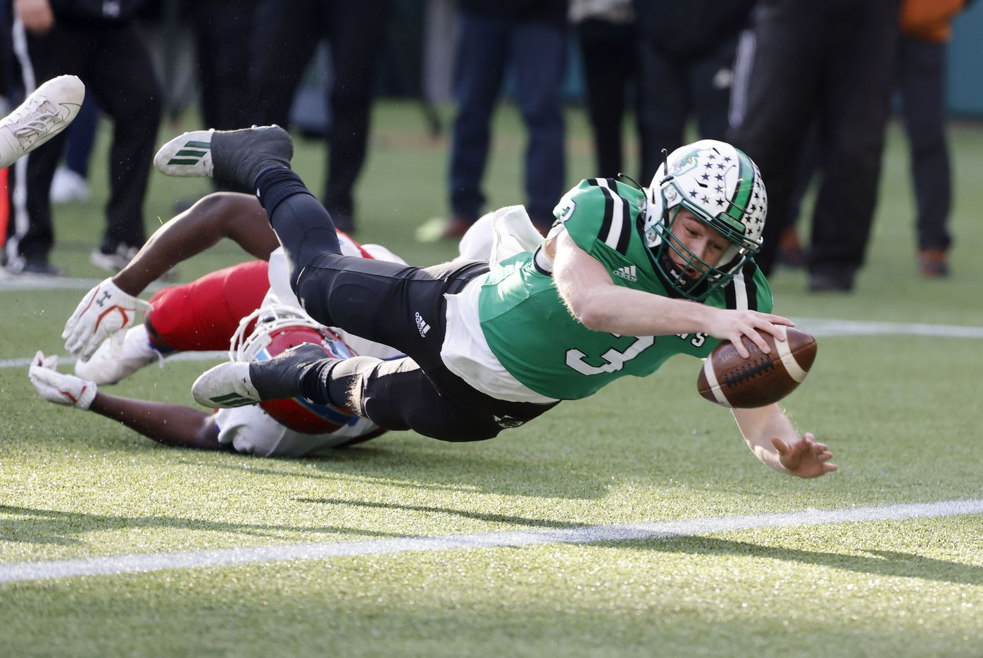 Southlake Carroll quarterback Quinn Ewers (3) dives for a touchdown against Duncanville during the Class 6A Division I state high school football semifinal in Arlington, Texas on Jan. 9, 2020. (Michael Ainsworth)