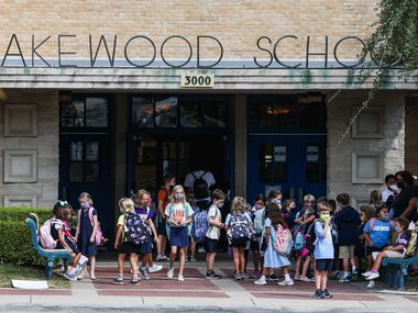 Children gather outside during dismissal time at Lakewood Elementary School, home to Dallas ISD's most affluent and whitest student body, and where some of the district's highest-rated teachers are on the faculty.