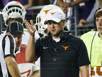 Texas head coach Tom Herman argues with referee Brad Van Vark during the second half of an NCAA football game against TCU at Amon G. Carter Stadium on Saturday, Nov. 4, 2017, in Fort Worth, Texas.