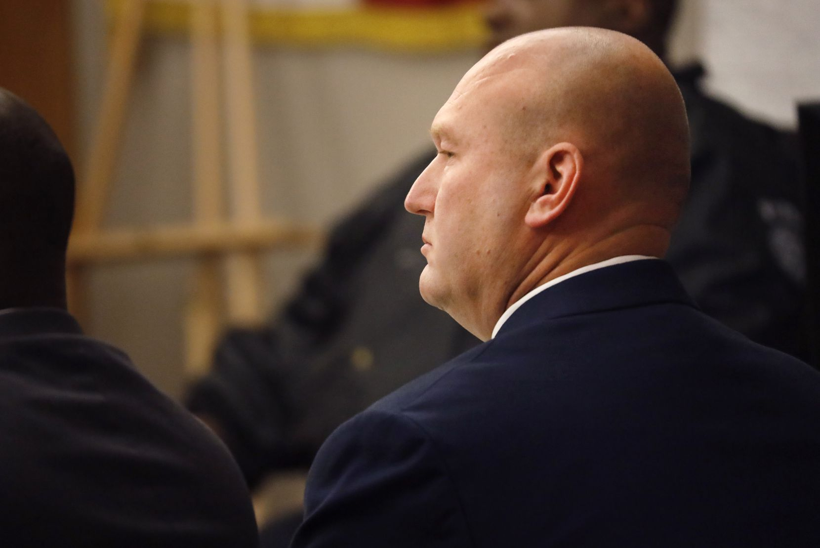 Former Dallas police officer Christopher Hess listens to testimony in his aggravated assault trial in the 292nd District Court at the Frank Crowley Courts Building in Dallas. The defense rested Tuesday, February 11, 2020. He's accused of the 2017 fatal shooting of 21-year-old Genevive Dawes. (Tom Fox/The Dallas Morning News)