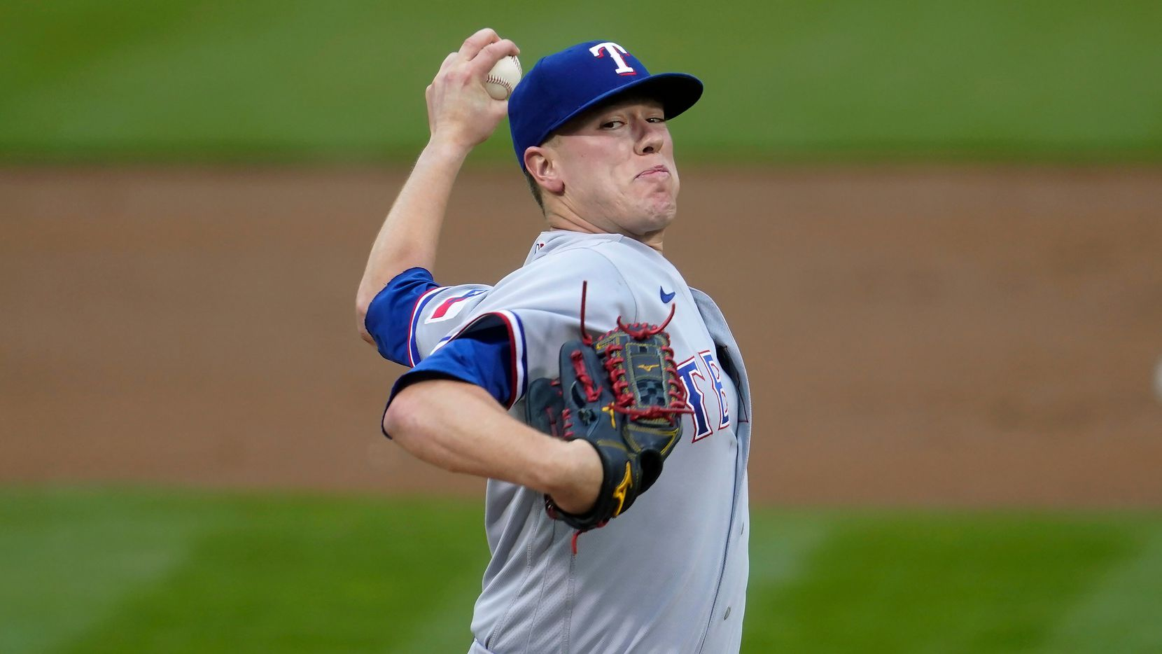 Texas Rangers' Kolby Allard pitches against the Oakland Athletics during the first inning of a baseball game in Oakland, Calif., Wednesday, June 30, 2021.