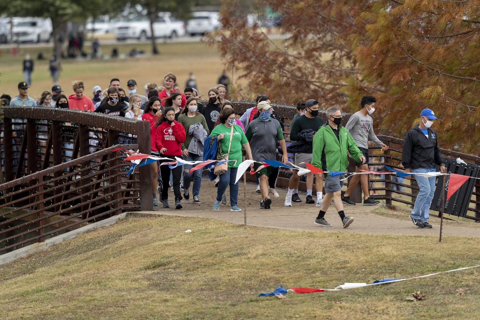 Spectators move through the race course looking for a spot to watch the boys UIL Class 4A state cross country meet in Round Rock, Tuesday, Nov., 24, 2020. (Stephen Spillman/Special Contributor)