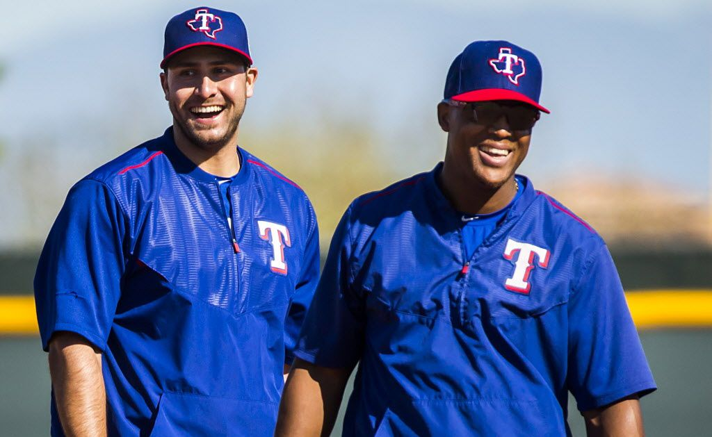 Texas Rangers third baseman Adrian Beltre (right) laughs with Joey Gallo while participating in a defensive drill during a spring training workout at the team's training facility on Thursday, Feb. 25, 2016, in Surprise, Ariz. (Smiley N. Pool/The Dallas Morning News)
