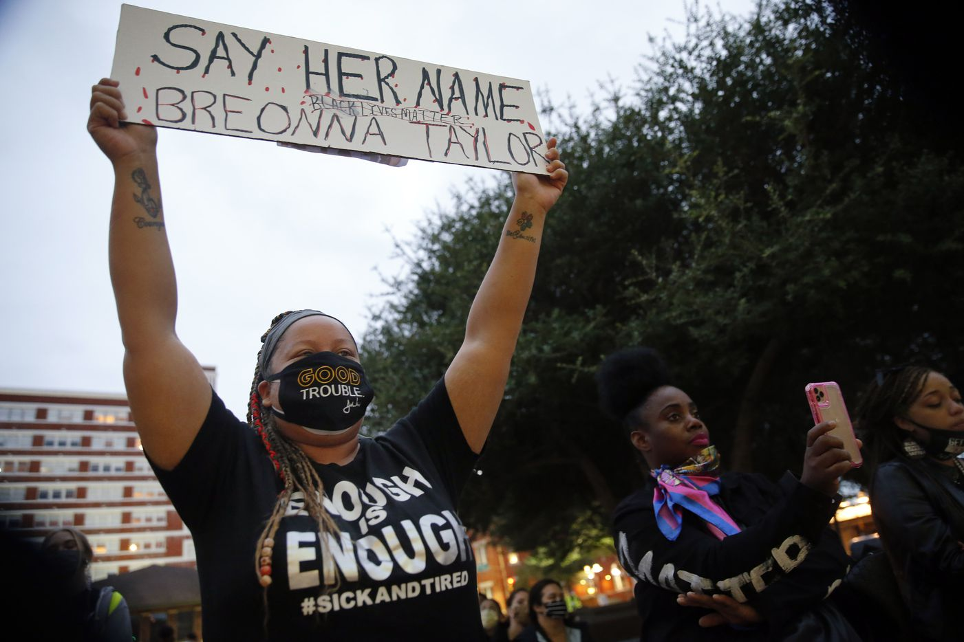 Shena Lee of Dallas proudly held her sign high in support of Breonna Taylor during a Next Generation Action Network protest outside of Dallas Police Headquarters. The group later marched down S. Lamar St. in Dallas, Wednesday, September 23, 2020. A Kentucky grand jury brought no charges against the Louisville police for the killing of Taylor during a drug raid gone wrong. (Tom Fox/The Dallas Morning News)