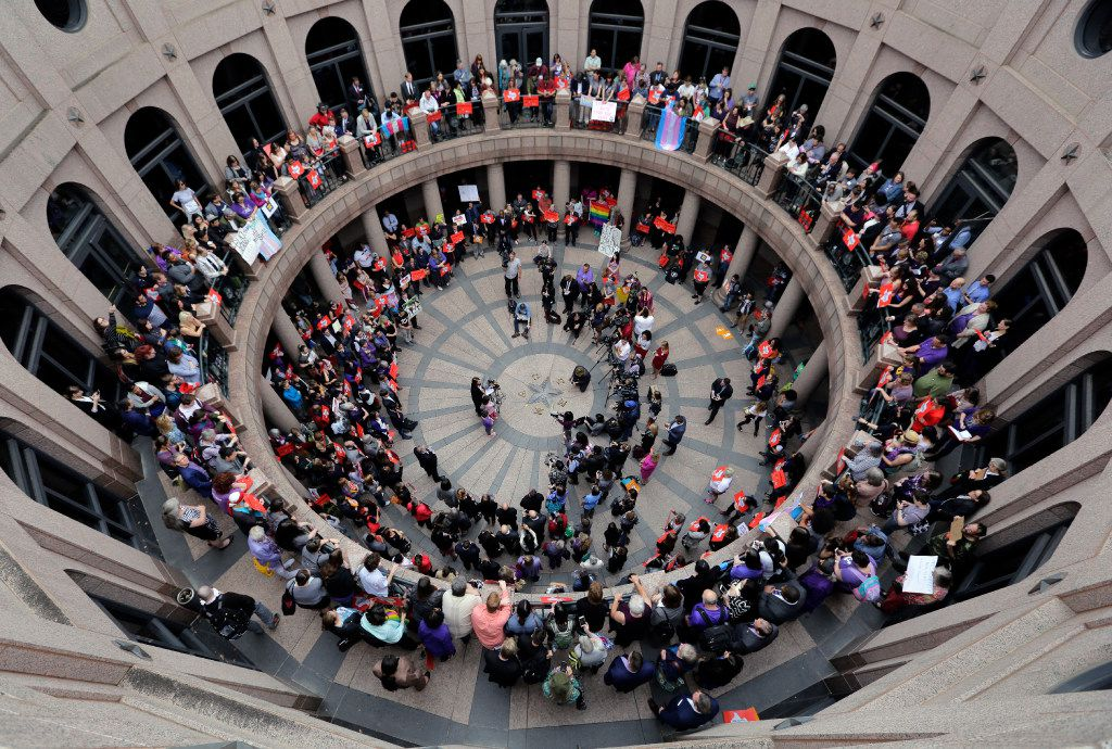 "Members of the transgender community and others who oppose Senate Bill 6 protest in the exterior rotunda at the Texas state Capitol as the Senate State Affairs Committee holds hearings on the bill, Tuesday, March 7, 2017, in Austin, Texas. The the transgender ""bathroom bill"" would require people to use public bathrooms and restrooms that correspond with the sex on their birth certificate. (AP Photo/Eric Gay)"
