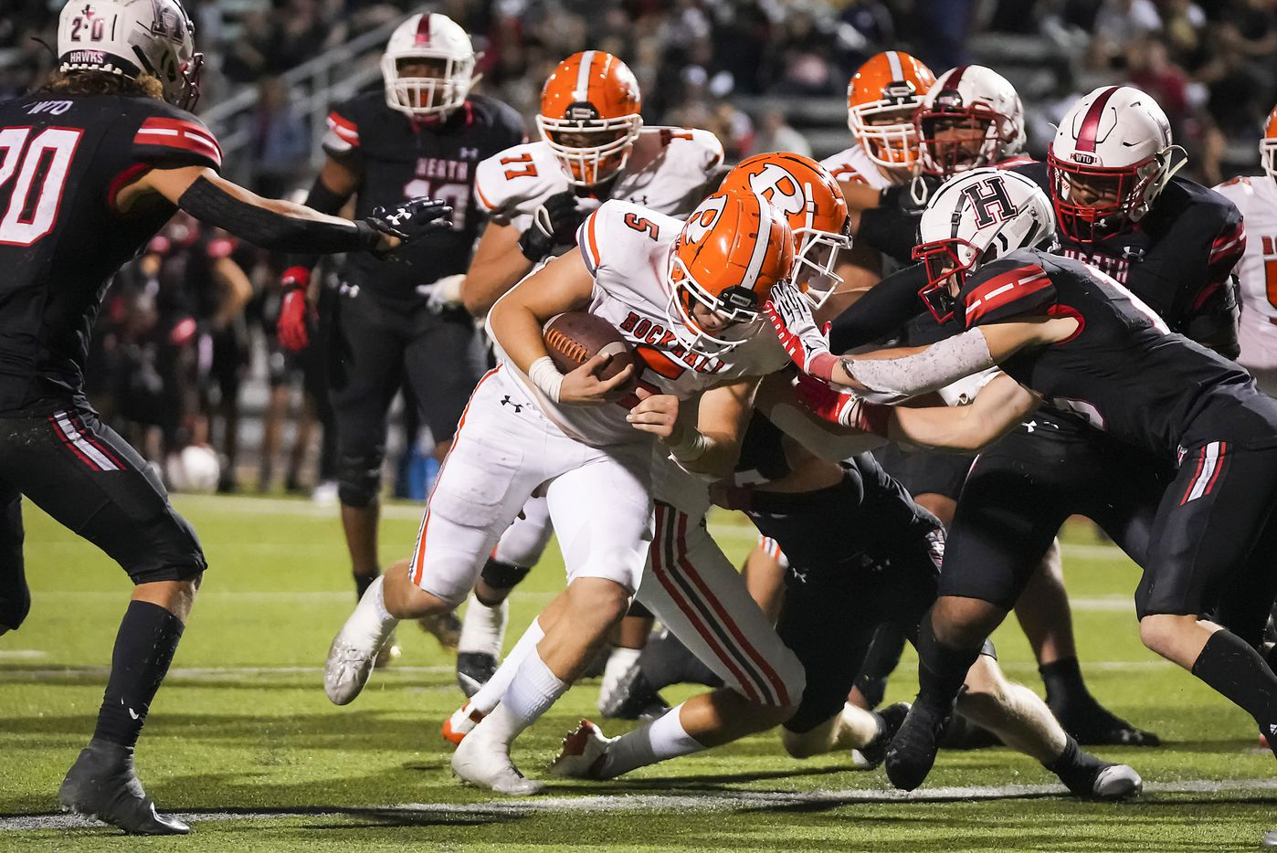 Rockwall quarterback Lake Bennett (5) scores on a 3-yard run during overtime in a District 10-6A high school football game against Rockwall-Heath at Wilkerson-Sanders Stadium on Friday, Sept. 24, 2021, in Rockwall.  Rockwall-Heath won the game 79-71 in double overtime.
