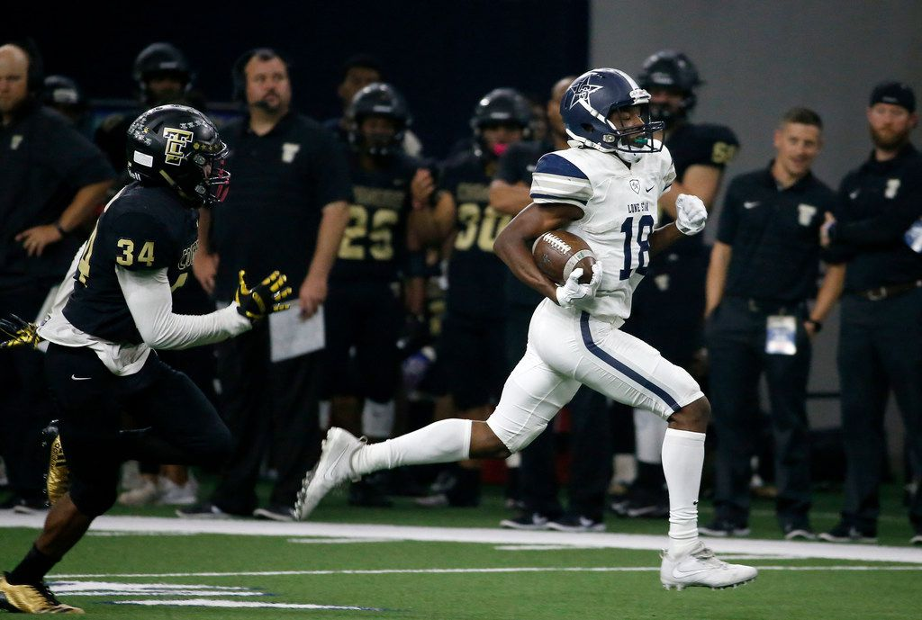 FILE - Frisco Lone Star's Marvin Mims (18) outruns The Colony's Ryan Dale (34) on the way to score a touchdown during the fourth quarter at The Ford Center at The Star in Frisco, Texas, Thursday, Nov. 16, 2017. (Jae S. Lee/The Dallas Morning News)
