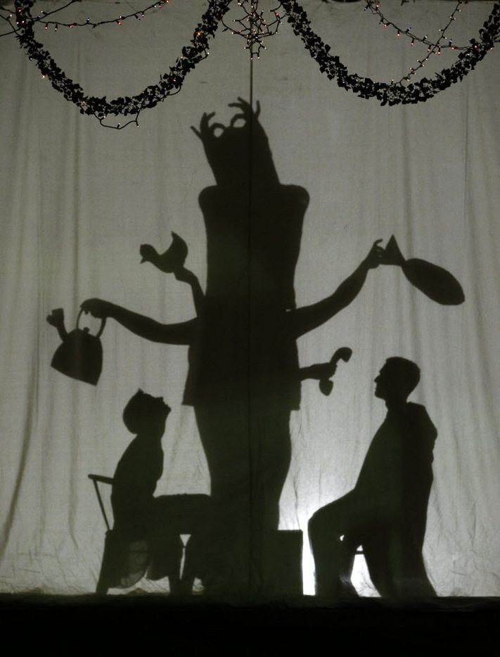 Silhouettes of Gracie Cuny (from left)  Jacky Burak and Dakota Ratliff in a dress rehearsal of Persephone, a piece from PrismCo at the Singleton Warehouse, Oct. 28, 2015.