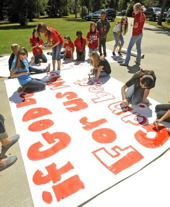 Kountze High School cheerleaders and other children worked on a large sign Wednesday in the small southeast Texas community. Many residents are rallying behind the high school's cheerleaders after they were told they could not use Bible verses on their signs at football games. (Dave Ryan/Beaumont Enterprise)