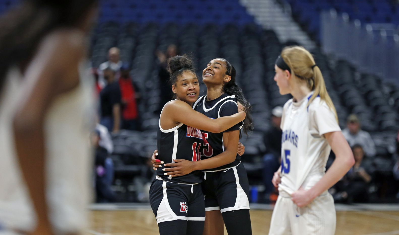 Duncanville guard Tristen Taylor #11 gets a hug from Duncanville guard Deja Kelly #25 as Cypress Creek can only watch in closing seconds in a 6A final on  Saturday, March 7, 2020 at the Alamodome.